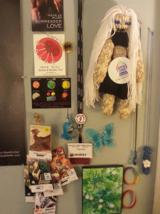 Kayelle's Wall showing OutlantaCon guest badges
